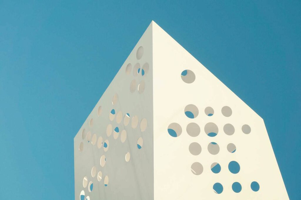 Minimal Building With Holes Under The Blue Sky