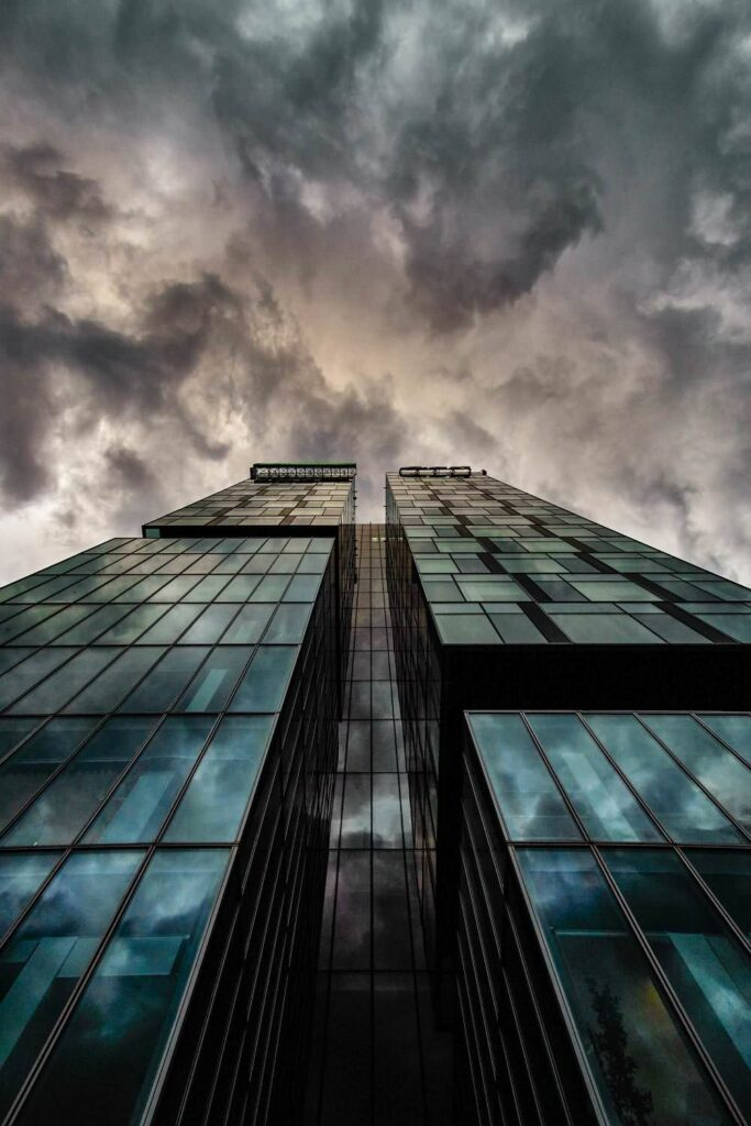 Cloudy  skyscraper windows building